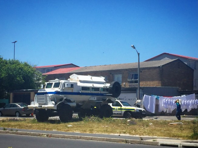 Police vehicles parked in Manenberg community, Cape Town, South Africa. October 2017.