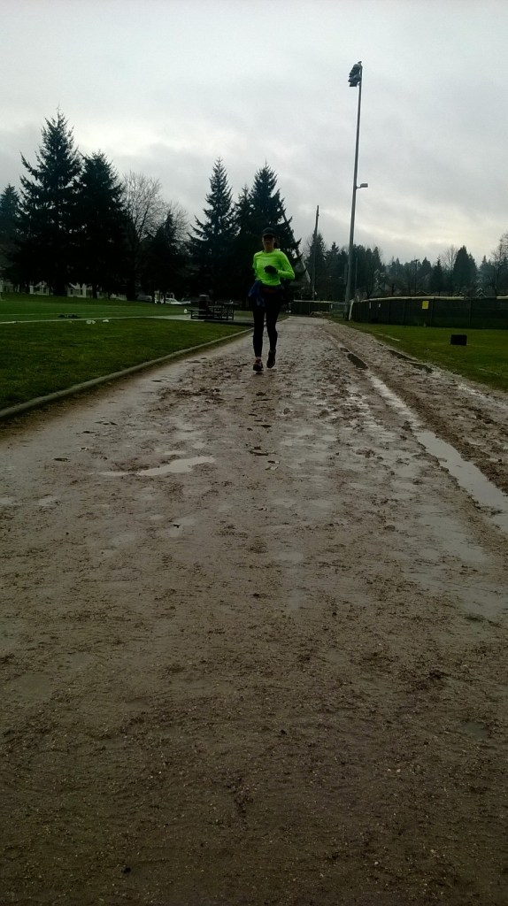 Julie finishing up her 5xmile workout on the dirt track.