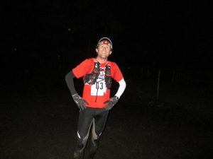 Finish photo after completing the 50k race in the dark.  Glad to be finished!