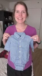 We've already started getting cute baby stuff thanks to our sister-in-law Erin. She has the hook up on cute baby clothes, including button-down onesies!