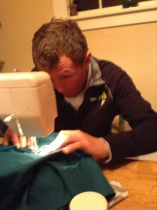 Sewing on my NSC patch onto my scrubs