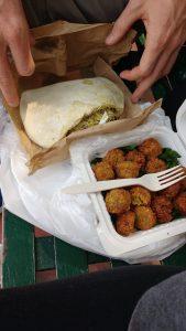 Falafel balls and falafel sandwich side by side