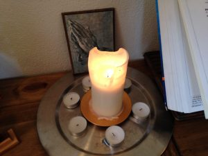 lit candle with tea lights