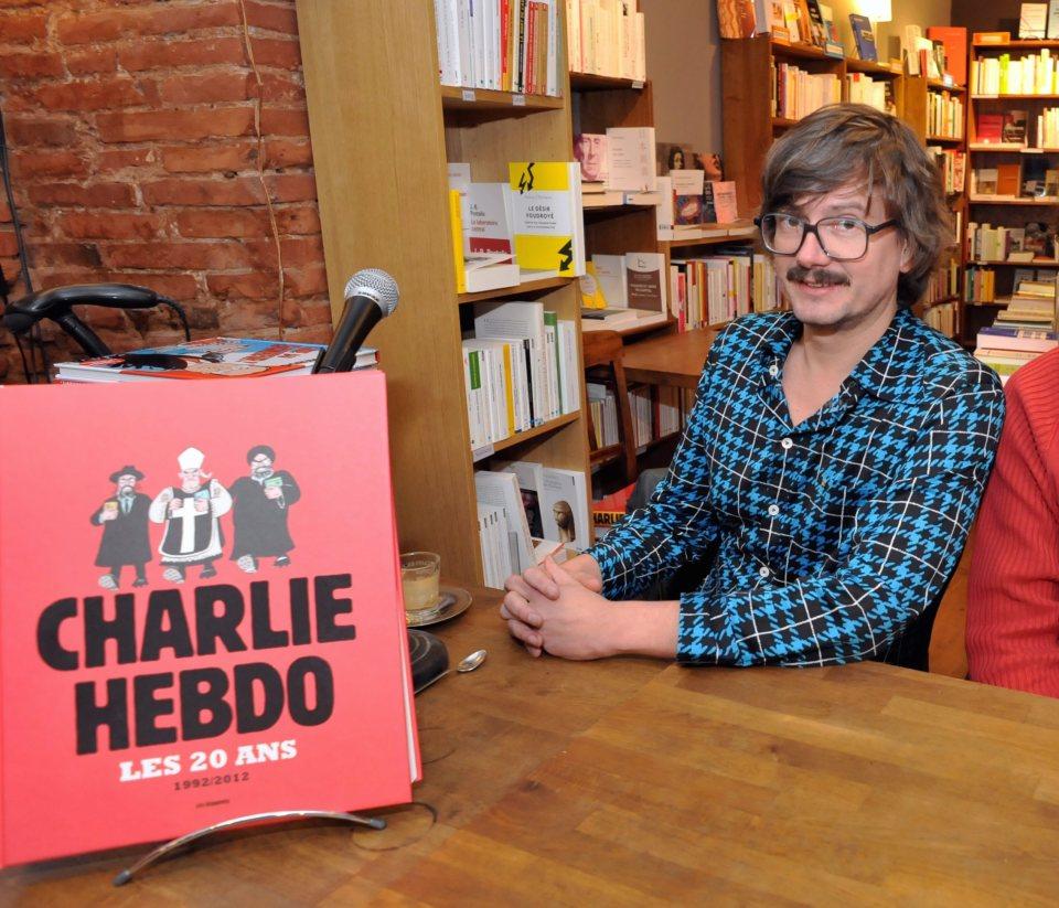 """Роналд Люзиер на представянето на юбилейното 20-годишно издание на """"Шарли Ебдо"""" през 2012 г.  ©EPA/БГНЕС"""