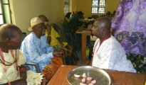 Comrade Dick Ani being Pryaed for by the oldest man Papa Umukoro in Otokutu communtiy