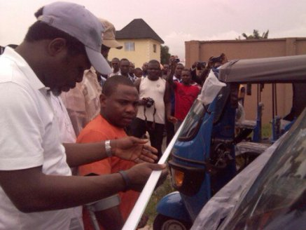 Sir Kenny Okolugbo about to commission the tricycles