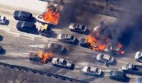 Cars are shown burning on the Interstate 15 freeway in the Cajon Pass, California in the frame grab from KNBC video