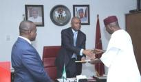Chief of Staff, Abba Kyari (r)  presenting the ministerial list to Senate President, Senator Bukola Saraki while   Special Adviser to the President on National Assembly (Senate), Ita Enang(left) look  on…..