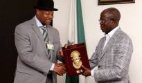 Boro receiving souvenir from Adam Oshiomole during his courtesy visit to the Governor