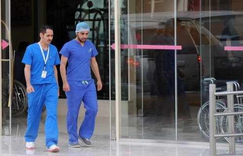 Saudi medical staff leave the emergency department at a hospital in the center of the Saudi capital Riyadh on April 8, 2014. A jealous father shot a male doctor at the King Fahad Medical City in Riyadh for assisting his wife's delivery.