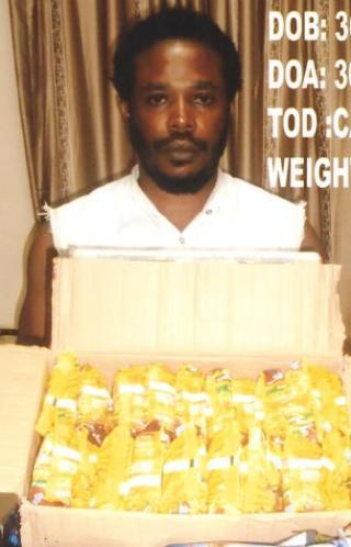 Esonwunne Onyechi Benson with the Indian hemp concealed in indomie packs