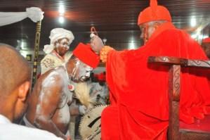Chief Samson Okuesa receiving chieftaincy title from HRM Ohworode of Olomu Kingdom