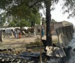 In this image supplied by MSF, smoke rises from a burnt out shelter at a camp for displaced people in Rann, Nigeria, Tuesday Jan. 17, 2017. Relief volunteers are believed to be among the more than 100 dead after a Nigerian Air Force jet fighter mistakenly bombed the refugee camp, while on a mission against Boko Haram extremists. (Medecins Sans Frontieres (MSF) via AP)