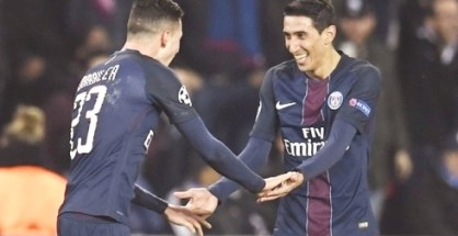 PSG's Angel Di Maria rejoices with team mate after scoring a brace against Barcelona