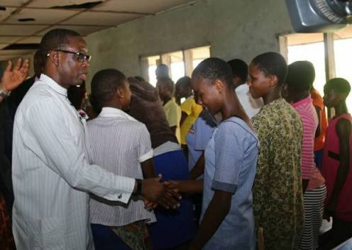 Delta State Governor, Dr Ifeanyi Okowa commiserating with some of the students of Chude Girls Model Secondary School, Sapele, affected by the iferno that razed the school's hostel