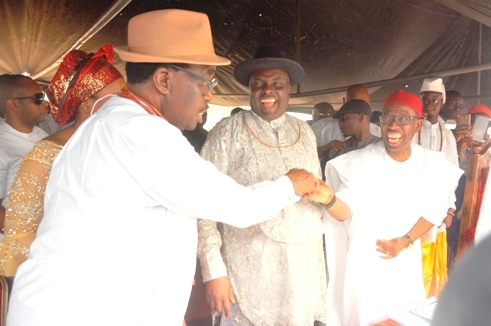 L-R- Chairman of the occasion Chief Johnson M Barovbe shaking Delta State Gov Ddr Ifeanyi POkowa, while Ibori look on with admiration