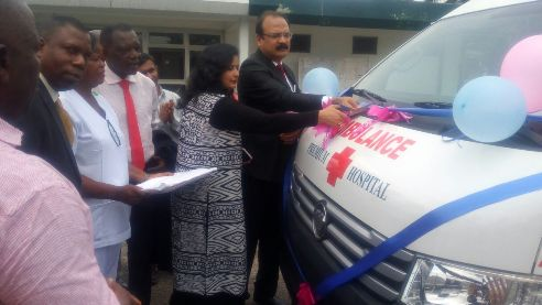 Mr and Mrs Prasanta Mishra cutting the tape to commission the ambulance donated by Premium Steel and Mines Limited to DSC Hospital last Saturday