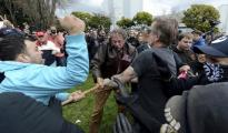 Counter-protesters try to take a large piece of wood away from a participant in a rally in support of President Trump at Martin Luther King Jr. Civic Center Park in Berkeley. (Dan Honda / Associated Press)