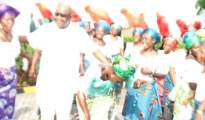 Dr Nelson Ejakpovi dancing with Emevor women during their solidiarityvisit to his country home in Benin City, Edo State