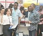 Governor Okowa discussing with a Chinese company representative during the tour