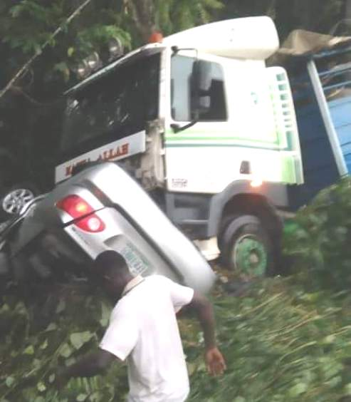 Delta: Man Escapes Death After Trailer Crushes His Car At Effurun