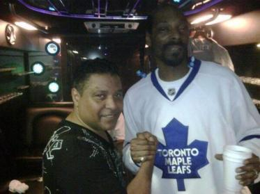 Snoop stops for a picture with a fan, looking majorly fresh in that blue-and-white Toronto Maple Leaf's jersey.