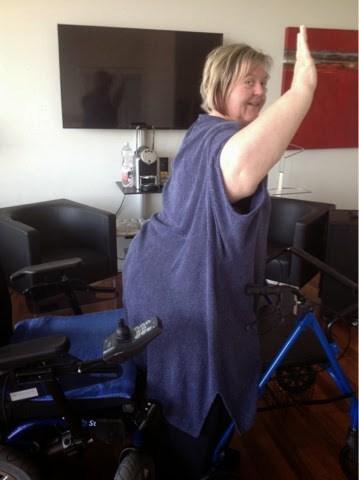 vom Rollstuhl aufstehen n