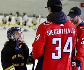 Siegenthaler and Jensen speak with a player.
