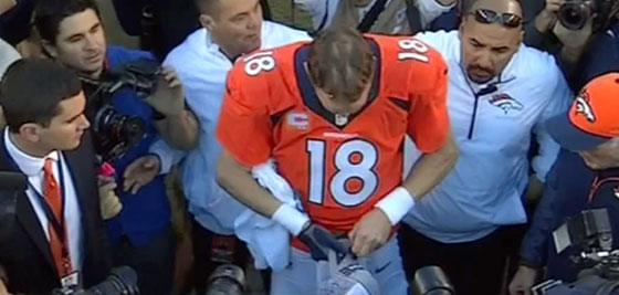 Peyton Manning Removes Stickers Hat
