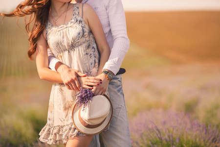 COUPLE IN LOVE: Young couple in love outdoor Stunning sensual outdoor portrait of young stylish fashion couple posing in summer in field