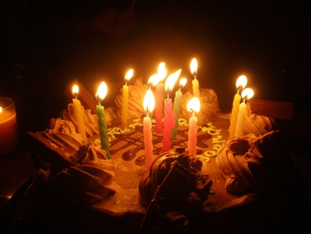 birthday cake and sweet candle light in the dark Stock Photo - 9227378
