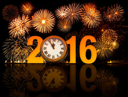 happy new year ICONS: 2016 happy new year fireworks with old clock face Stock Photo