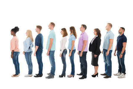Full length side view of creative business people standing in row against white background Stock Photo - 48353568