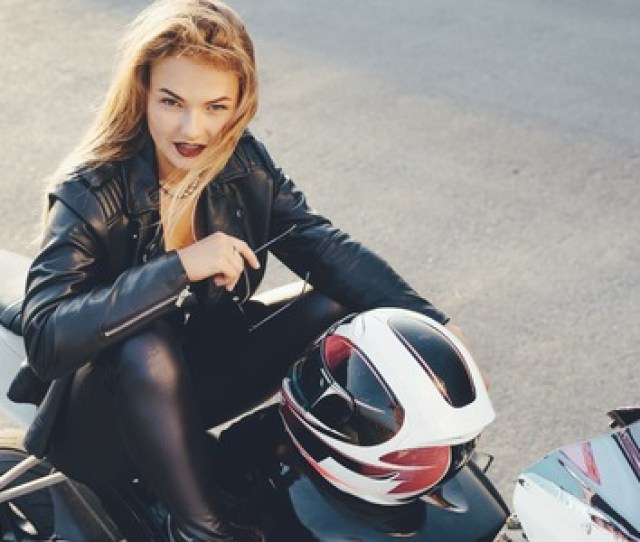 Biker Girl In A Leather Clothes On A White Motorcycle Sexy Young Woman Biker Sitting