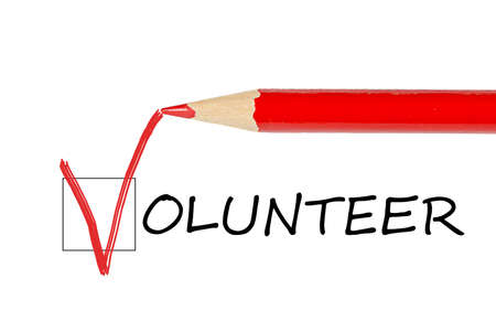 Volunteer message and red pencil isolated on white background Stock Photo - 12310275