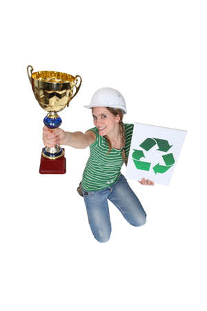 Woman jumping and holding a trophy Stock Photo - 18099662