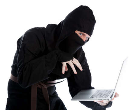 ninja computer: Attractive 30 years old caucasion man shot in studio isolated on a white background Stock Photo
