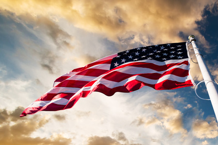 american flag: american flag waving blue sky Stock Photo