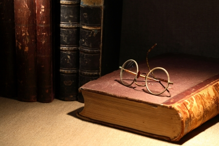 Vintage still life with old books and spectacles on canvas surface Stock Photo - 11697481