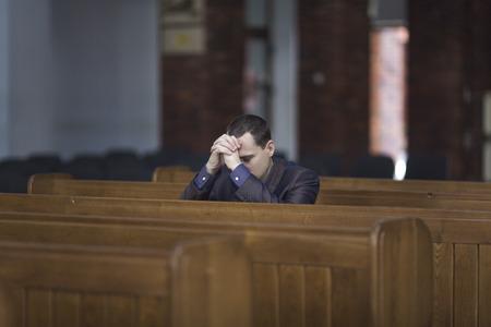 Man praying in church Stock Photo - 38789205