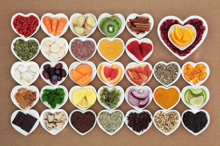 cold food: Health food for flu and cold remedy cures high in antioxidants and vitamin c with tablets, medicinal herbs and spices in heart shaped dishes.