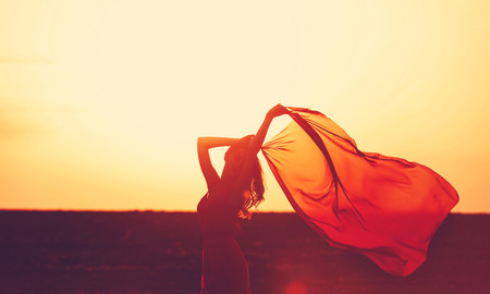 Women with fabric on sunset. Stock Photo - 31106694