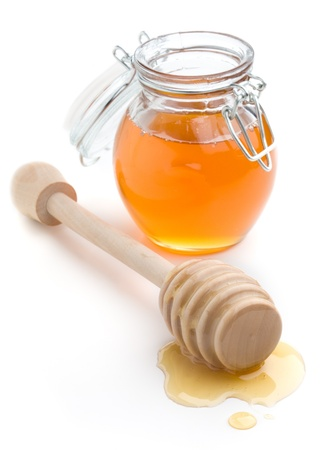 small honey: Liquid honey in small glass jar, white isolated background Stock Photo
