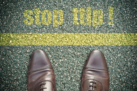 ttip: concept signage on the road with feet and yellow line - stop ttip !