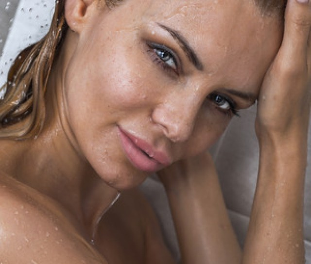 Portrait Of Blonde Beautiful Woman Under Shower Wet Body Girl Looking At Camera