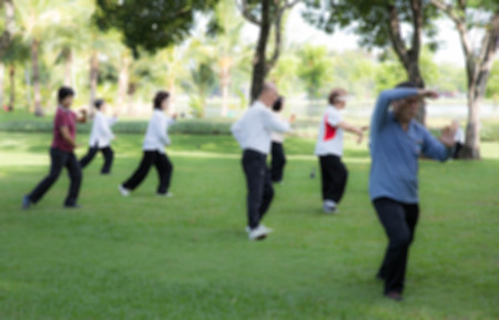 tai chi: Style blur People practising tai chi in the park