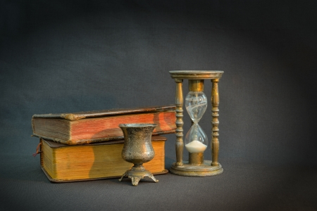 Vintage books and hourglass in dark room Stock Photo - 22546174