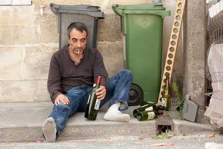 sad drunk man sitting on sidewalk near trashcan Stock Photo - 7713120