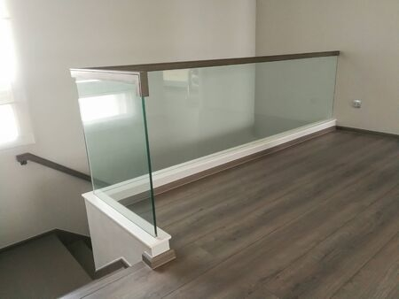 Corridor Staircase Railing With Modern Glass Stock Photo | Staircase Railing With Glass | Low Cost | Cost | Residential | Pinterest | Spiral