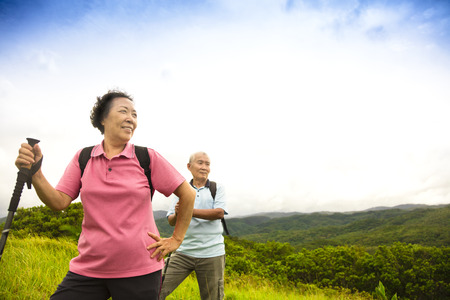 asian elderly: happy senior couple hiking on the mountain Stock Photo